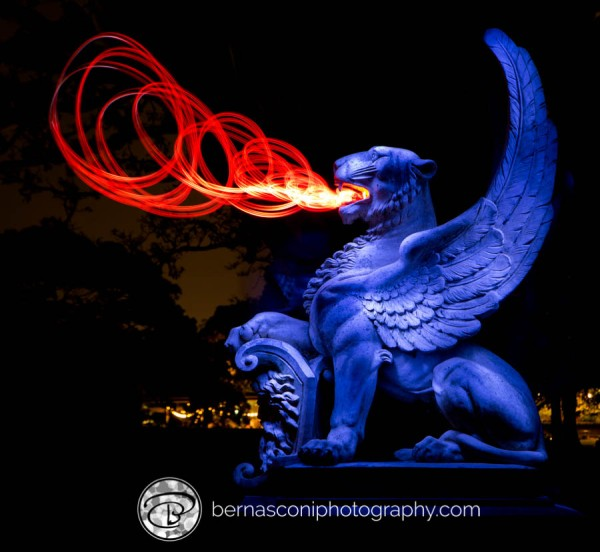 Painting the statue blue combined with a moving light for a 'fire' effect.