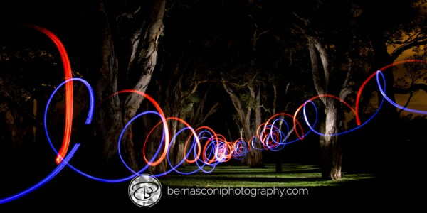 Light painting combined with a moving, coloured torch effect.